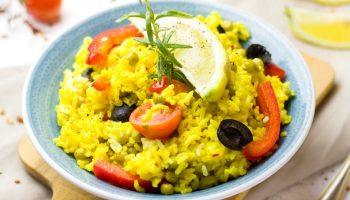 a bowl of yellow rice, and vegetables