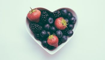 berries in a heart shaped bowl