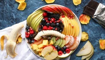 a breakfast bowl of many different fruits