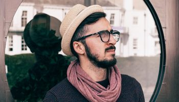 a hipster with glasses, a hat and a scarf