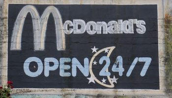 street mural of McDonalds logo and opening times