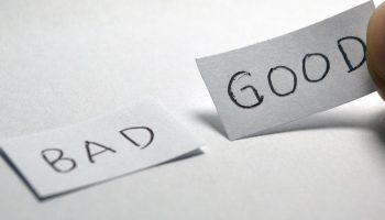 "two paper notes with the word ""bad"" and ""good"" on them"