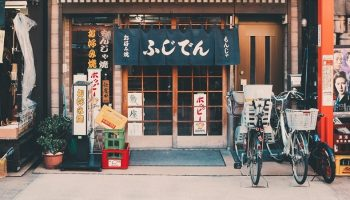 a Japanese street surrounded by Japanese signs