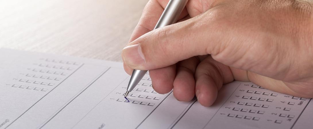 man filling out a multiple choice survey