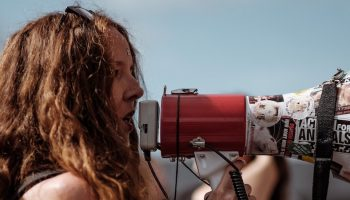 a woman talking into a megaphone
