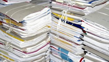 piles of paper stack on one another