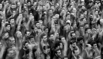 black and white image of a crowd of people