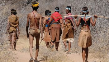 a tribe of native Africans walking