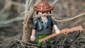 a miniature toy hunter with a shotgun