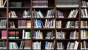 bookshelf of research books
