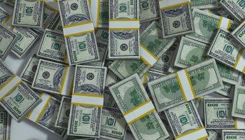stacks of hundred dollar bills on the floor