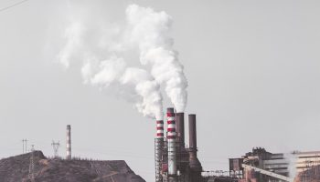 a factory emitting air pollution from its chimney