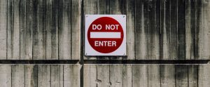 "a red sign stating ""DO NOT ENTER"""