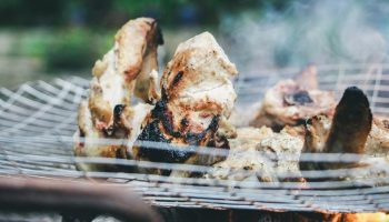 poultry being cooked on a fire