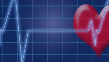 cartoon heart behind a heart rate monitor