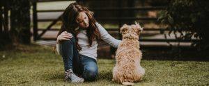 a child petting her companion animal