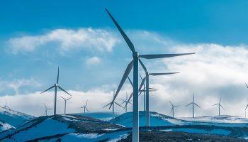 wind farm on a snowy mountain