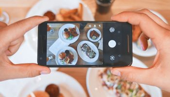 taking a picture of a meal with phone