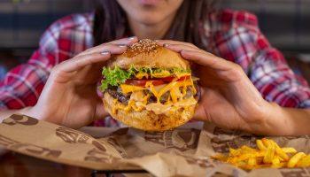 holding a burger