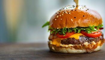 burger on wooden surface